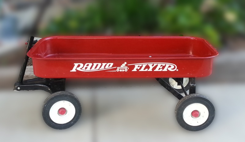 little red wagon before miniature garden