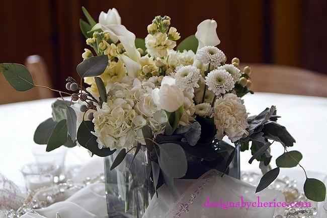 Hydrangea,roses, cremone, mini callas, tulips, button mums, hypericum berries, dusty miller and seeded eucalyptus