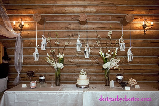 Rustic chic Colorado Mountain wedding tall white centerpieces with white lanterns