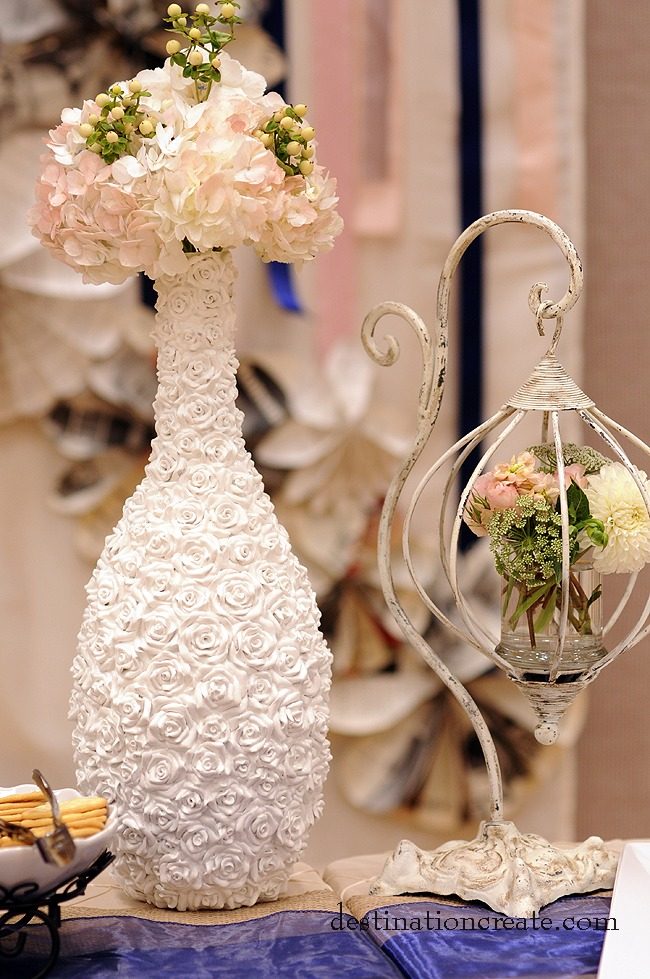 Rent this stunning one of a kind white rose encrusted vase for a very romantic floral piece.