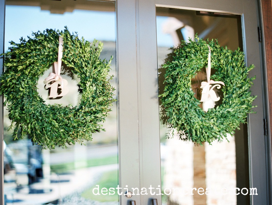 Boxwood wreaths welcome guests to this lush wedding in Golden CO