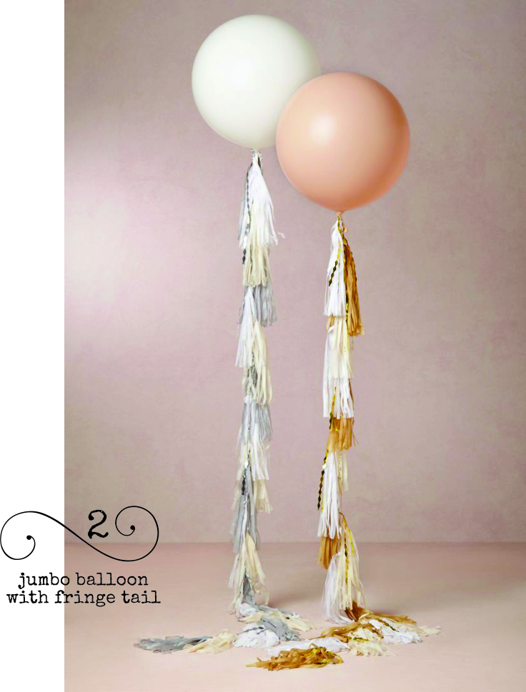 Attach a tissue tassel garland tail to a jumbo balloon for a funky centerpiece