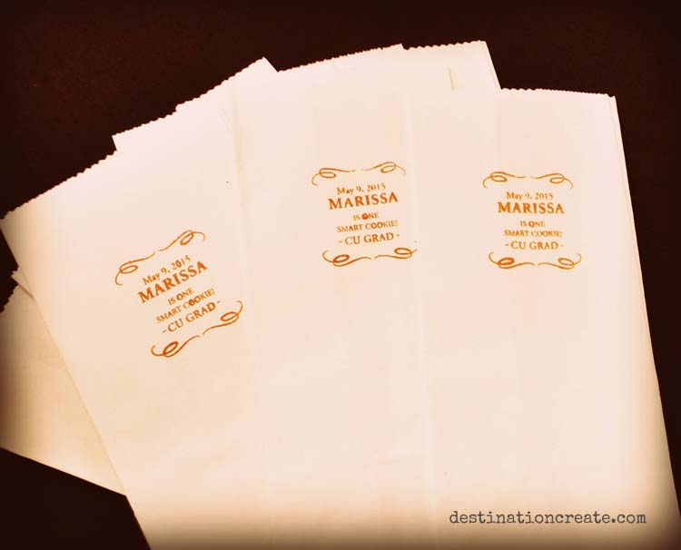 I stamped paper sacks with a custom stamp for these memorable goody bags at the party favor table.