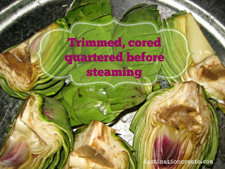 Grilled artichokes halved with chokes removed and prepped for steaming