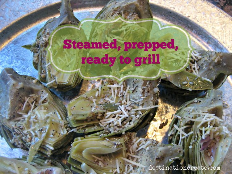 Grilled artichokes halved with chokes removed and prepped for grilling